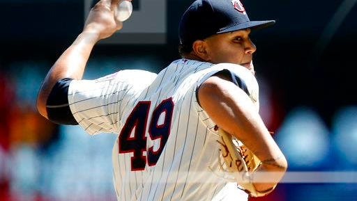 Minnesota Twins pitcher Adalberto Mejia throws against the Detroit Tigers in the first inning of a baseball game Saturday, April 22, 2017, in Minneapolis.