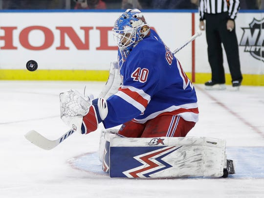 New York Rangers goaltender Alexandar Georgiev (40) stops a shot on goal by during the first period of an NHL hockey game against the Pittsburgh Penguins Tuesday, Nov. 12, 2019, in New York. (AP Photo/Frank Franklin II)