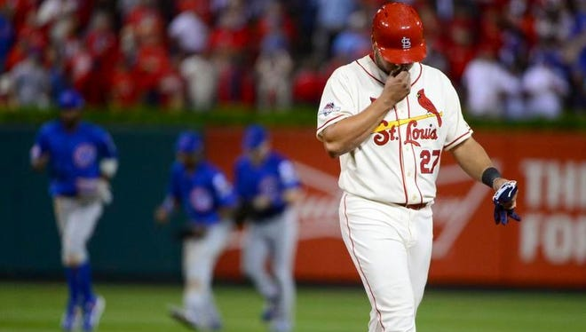 Jhonny Peralta walks off the field after the St. Louis Cardinals lost Game 2 of the NLDS 6-3 Saturday to the Chicago Cubs in St. Louis.