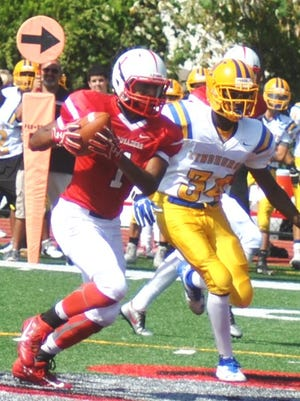 Elmwood Park's Kevin Perez (1) caught 25 passes for 678 yards and three touchdowns last fall.