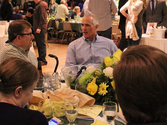 Kathy Farinaccio (far left), former president of the Vineland Chamber of Commerce, sits with family and friends at the dandelion dinner.
