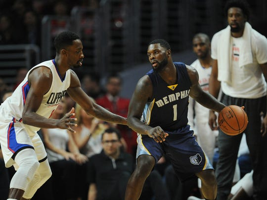 April 12, 2016; Los Angeles, CA, USA; Memphis Grizzlies forward Lance Stephenson (1) moves the ball against Los Angeles Clippers forward Jeff Green (8) during the second half at Staples Center. Mandatory Credit: Gary A. Vasquez-USA TODAY Sports