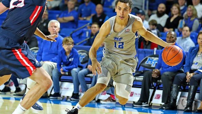 MTSU freshman guard Therren Shelton-Szmidt drives to the basket in a game against Belmont on Thursday.