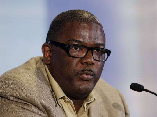 In this July 16, 2013, photo, Detroit Pistons President of Basketball Operations Joe Dumars speaks during a news conference in Auburn Hills, Mich. The Pistons have decided not to renew Dumars' contract as president of basketball operations, a person familiar with the situation said Sunday, April 13, 2014. The person, who spoke on condition of anonymity because the team has not made any announcement on Dumars' future, says Dumars will remain with the Pistons as an adviser. (AP Photo/Carlos Osorio)