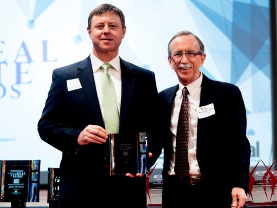 James Roberson and Knoxville News Sentinel Executive Editor Jack McElroy during the annual Commercial Real Estate Awards at Bridgewater Place in West Knoxville, Tennessee on Thursday, February 8, 2018.