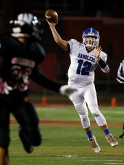 The Ramblers of Carteret High School traveled down the New Jersey Turnpike to take on the Barrons of  Woodbridge High School for a varsity football game in Woodbridge on Friday October 14, 2016.Carteret's # 12 quarterback Angelo Golino III (right) throws a 1st half touchdown pass.