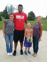 Trey Moses poses with Anne, Luke and Marcie Vormohr.