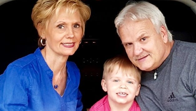 Tim Sagert, of Sterling Heights, discovered that fraudsters applied for Social Security benefits with his ID information. Pictured with his wife Janet Sagert and grandson Brody Andersen, age 4.