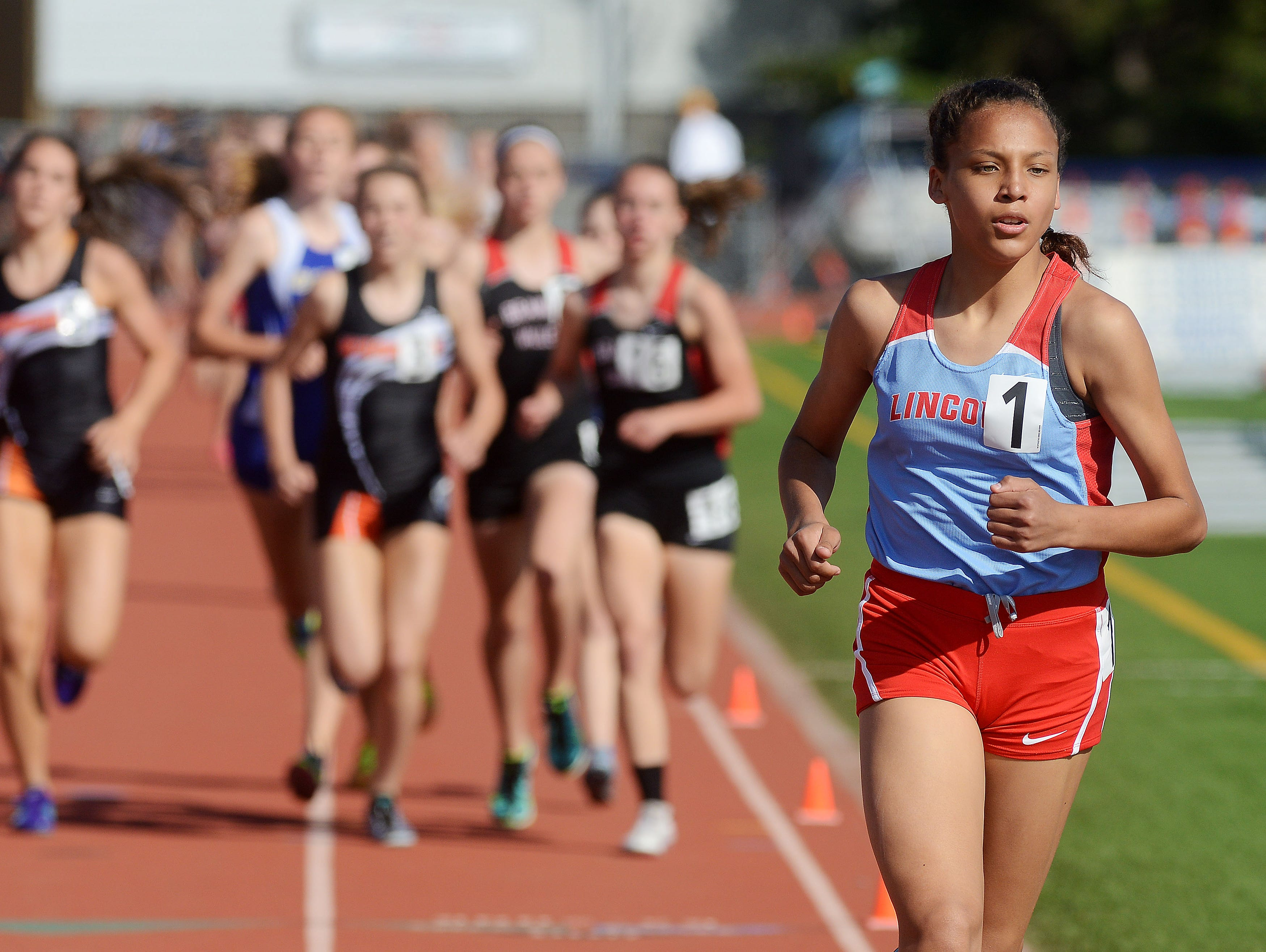 Jasmyne Cooper Lincoln holds a strong lead to win the girls 1600 meter run Friday at the Metro Conference track meet at O'Gorman, May 8, 2015.