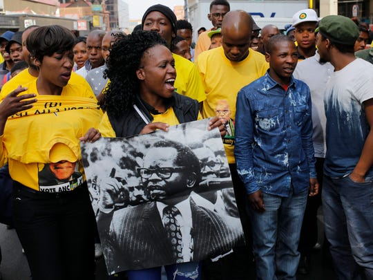Members of the ANCYL (African National Congress Youth League) sing as they protect the party head offices against an anti-ANC march by party members that attempted to reach Luthuli House in Johannesburg, South Africa, on Sept. 5, 2016. The demonstrators wanted the party president and South African President, Jacob Zuma, and the NEC  to resign after poor results in the recent local elections.