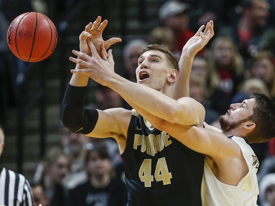 Purdue Boilermakers center Isaac Haas (44) is tightly