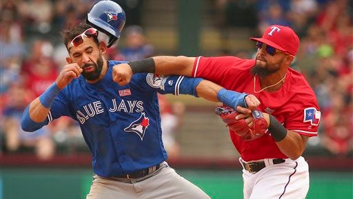 Toronto Blue Jays Jose Bautista (19) gets hit by Texas Rangers second baseman Rougned Odor (12) after Bautista slid into second in the eighth inning of a baseball game at Globe Life Park in Arlington, Texas, Sunday.