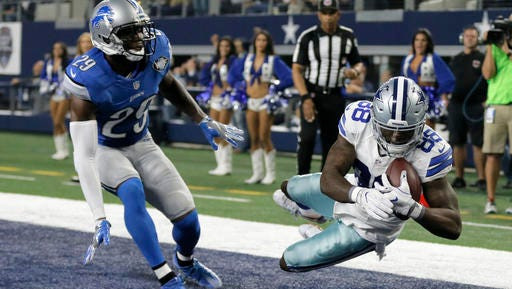 Detroit Lions' Johnson Bademosi (29) is unable to stop Dallas Cowboys' Dez Bryant (88) from catching a touchdown pass late in the first half of an NFL football game, Monday.
