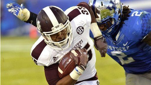 Mississippi State's Gabe Myles, left, is pursued by Kentucky's Alvin Dupree during the third quarter of an NCAA college football game at Commonwealth Stadium in Lexington, Ky. on Saturday.
