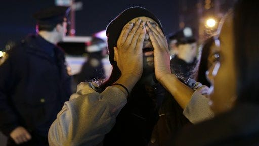 A woman is overcome with emotion during a protest against the grand jury's decision in the Eric Garner case in Times Square in New York, Wednesday.