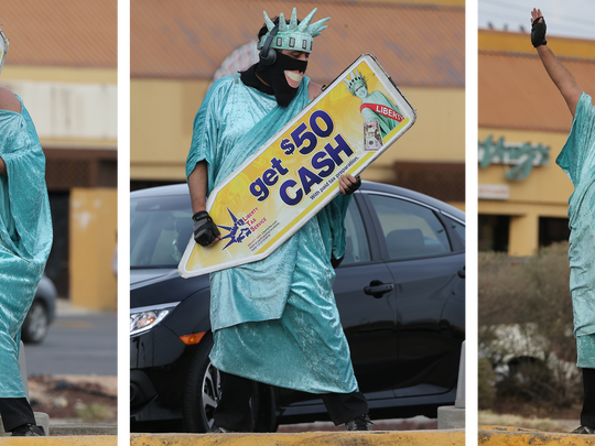 "Charlie Villagrana listened to music as he played on his ""sign guitar"" in 2017 on Montwood Drive near George Dieter Drive. Villagrana was dressed in a Statue of Liberty outfit to draw customers to a nearby income tax service."