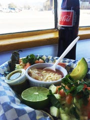 Alambre tacos ($5.99) — bacon, bell pepper and Munster cheese — and a Mexican coke ($2.50).