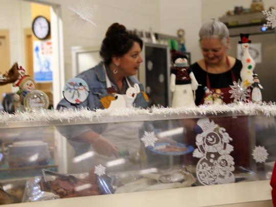 Cindy Iacovetto and Kathy Lamb serve meals, Monday, Dec. 25, 2017, at the Aztec Senior-Community Center.