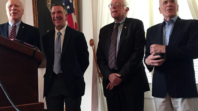 Sen. Patrick Leahy, from left, Sen. Bernie Sanders, Vermont Gov. Phil Scott and Rep. Peter Welch laugh during a news conference about health care in Montpelier on July 17, 2017.