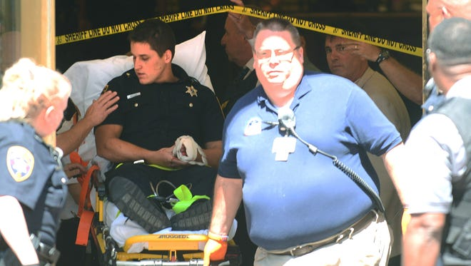 An unidentified Chester County, Pa., sheriff's deputy is taken from the lobby of the Chester County Courthouse after he was slashed by Curtis Smith, of Coatesville, Pa., who was then shot and killed by another deputy. Smith had been arrested in March 2015 after he jumped a stone wall at the White House.