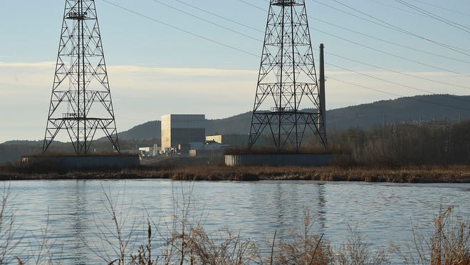 The waters of the Connecticut River reservoir are still in front of the Vermont Yankee nuclear power plant, across from Hinsdale, N.H. on Dec. 29, 2014. Vermont's only nuclear plant stopped sending power to the New England grid Monday following more than 42 years of producing electricity.