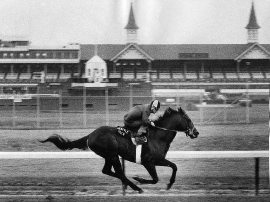 Jockey Jean Cruguet brings Seattle Slew around the track for an early morning workout. Seattle Slew went on to win the 1977  Kentucky Derby.