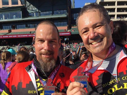 John Varnick, left, runs the St. Jude Half-Marathon