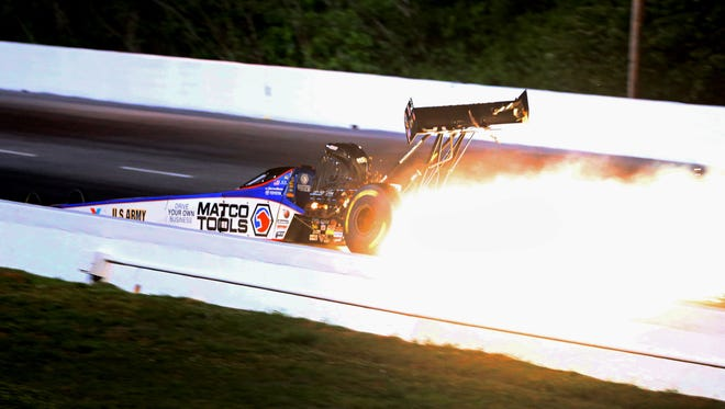 Antron Brown loses his rear wing in an explosion before crashing during qualifying for the Southern Nationals at Atlanta Dragway.