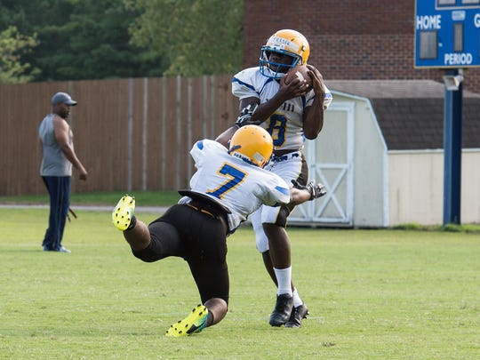 Two Wi-Hi players practice a passing play at Wicomico High School on Thursday, Aug. 17.