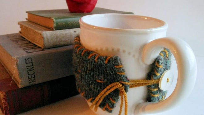 Turn a felted wool sweater (or craft felt) into a charming mug sweater cozy with a few simple supplies.
