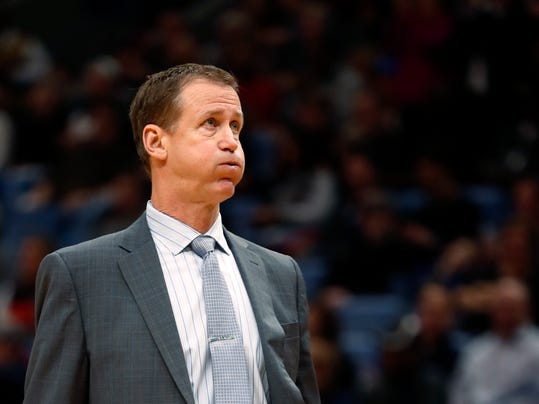 Portland Trail Blazers coach Terry Stotts walks onto the court after calling a timeout during the first half of the team's NBA basketball game against the New Orleans Pelicans in New Orleans, Friday, Jan. 12, 2018. The Pelicans won 119-113. (AP Photo/Gerald Herbert)