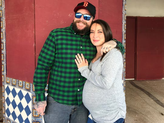 Michael Ledbetter and his fiancee Devin Nordin look forward to better days.