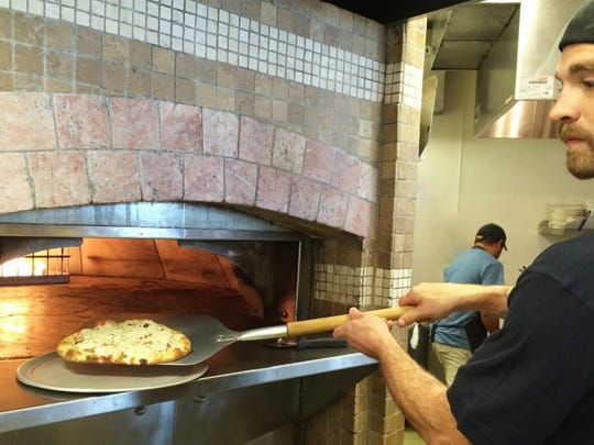 Billy Petro said they can bake one of their flatbreads in around four minutes at their West Hills Flats & Taps location.