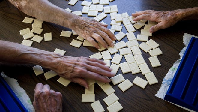 Rummikub players Fay Newton, Agnes Bruce and Norma Shultz mix up the tiles before diving in to another game at the Lewisport Senior Citizens Center Tuesday afternoon.