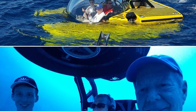 Auction winner John Mills (below right) with his grandson, Johnny Vincent (left), join Triton submarine pilot Troy Engen on a deep dive off the Bahamas on Jan. 20.