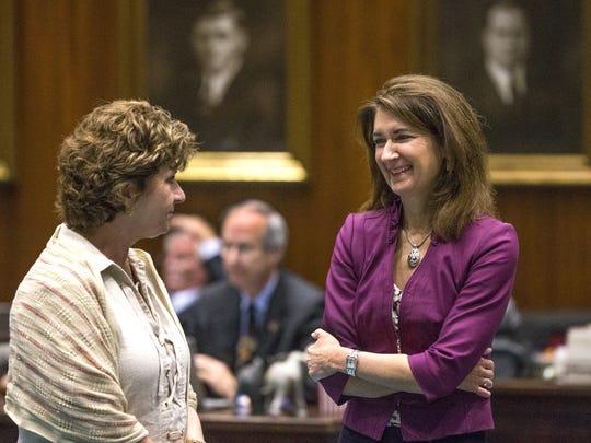 Rep. Becky Nutt, R-Clifton, left, talks with Rep. Jill
