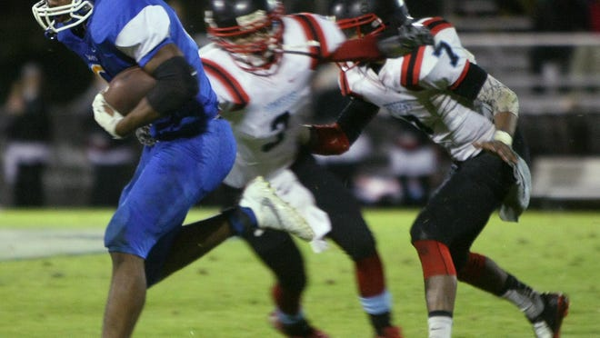 Jackson Christian running back Rufus Whitmore runs for a big gain against Gibson County during their game last week at Jackson Christian.