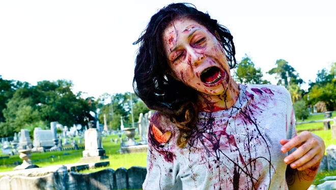 Karie Pennise gets into character ahead of Saturday's Zombie Run in downtown Pensacola. Makeup by Lemmie Crews.