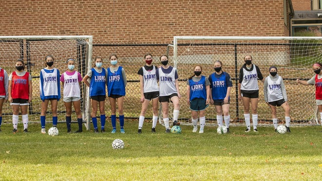 The West Boylston High girls' soccer  team includes seven sets of sisters, seen at practice Monda. They are, left to right, Mia and Sam Guinto, Madison and Emily Pitro, Sonia and Olivia Downer, Kara and Mary Wattu, Meaghan and Kaitlin Flaherty, Emma and Molly Nett, and Nicole (not pictured) and Serephine Jodoin.