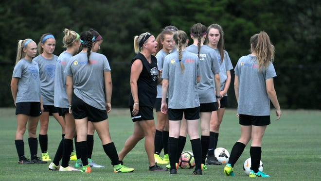 Coach Nicole Aquila and members of the Tennessee Soccer Club's 2003 girls showcase soccer team train for US Youth Soccer National Championships in Frisco, Texas at Williamson County soccer complex in Franklin on July 17, 2017.