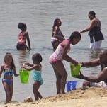 Crowds enjoy the beach at Rye Playland Beach on July 6, 2016.