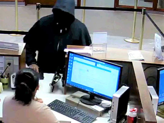 Deputies are searching for the male who robbed CFCU Community Credit Union at gunpoint.