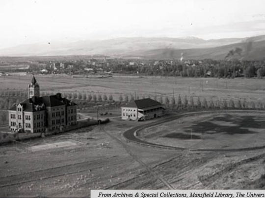 In 1904, Main Hall, gym, football field, tennis courts and city of Missoula from Mount Sentinel.