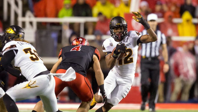 Oct 17, 2015: Arizona State Sun Devils wide receiver Tim White (12) runs after receiving a kickoff as Utah Utes defender Austin Lee (4) moves in for the tackle during the second half at Rice-Eccles Stadium. Utah won 34-18.
