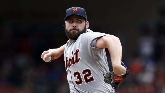 Detroit Tigers starting pitcher Michael Fulmer throws against the Texas Rangers on Aug. 14, 2016, in Arlington, Texas.