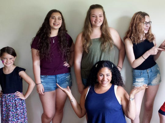 Among the students of Ayana Del Valle (center) performing Tuesday will be, from left, Lexi Tokkos, Kazmira Wells, Paige McNett, Amy Tye and Michael Tye.