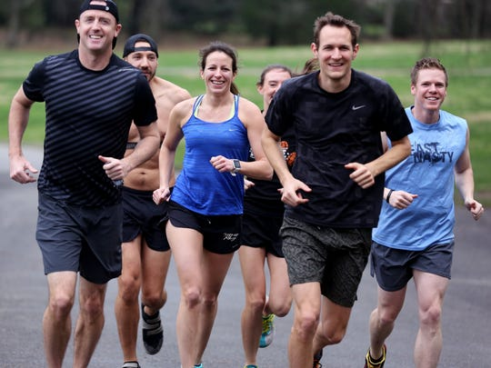 Drew Jones, left, runs with Graham Stoner, Margaret Jones, Emily Day, Matt Drewes and Daniel Hudgins along the trails of Percy Warner Park in December 2015. A few of these same friends will join Jones to run 13.1 miles along part of the Rock 'n' Roll half marathon course on Saturday even though the 2020 race has been postponed due to the coronavirus pandemic. Jones has run the half marathon in April every year since 2002.