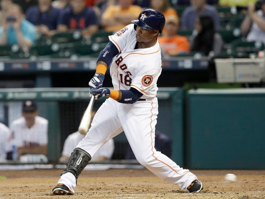 Houston Astros' Luis Valbuena swings for a third strike against the San Francisco Giants in the first inning of a baseball game Tuesday, May 12, 2015, in Houston. (AP Photo/Pat Sullivan)