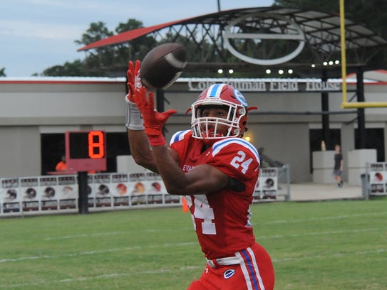Evangel's Ar'darius Washington hauls in a catch against