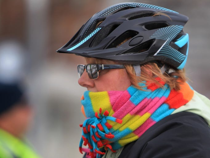 Cold and bundled, a cyclist rides in Mayor Ballard's 3rd Annual Polar Bear Pedal, Saturday, January 4, 2014.